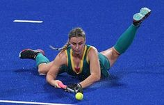 Australia's Mariah Williams blocks the ball during the women's field hockey match against Britain.