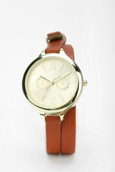 """Double Strapped Watch – long vegan leather wrap watch with an over-sized face. A large time dial with ornamental double dials.  Polyurethane, mixed metal, glass, can be wiped clean, imported and face size with is 1.25"""""""