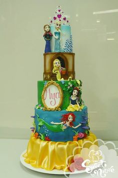 disney birthday cake! Elsa and Anna from Frozen, Rapunzel from Tangled, Snow White, and Ariel from the little mermaid!