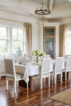 Love this space...plank walls, linen drapes and upholstery. The corner cabinet is fabulous! Abby M. Interiors