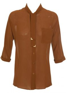 Crepe silk blouse with self-tie neck and collar tips by Fendi. Semi-sheer. One chest patch pocket. Unlined. Relaxed fit. Hemline finishes at the upper thigh. Tortoise shell button down front. Three-quarter length sleeves with turned up cuffs.  100% silk