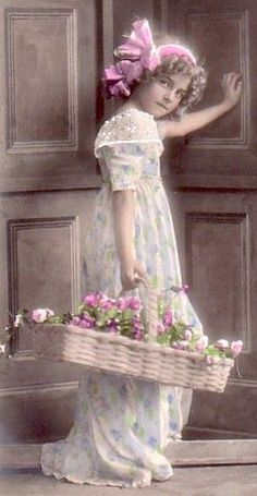 Victorian girl with basket of flowers...