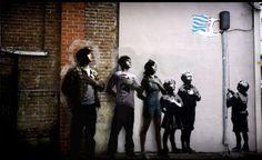 Banksy artwork on Essex Road, Islington, London. The piece shows children pledging their allegiance to supermarket giant Tesco.