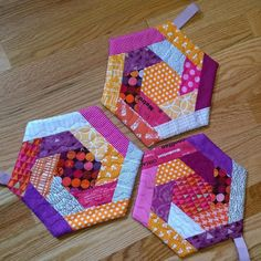 Looking for sewing project inspiration? Check out Hot Log Cabin Hexi Potholders by member AQuiltersTable.