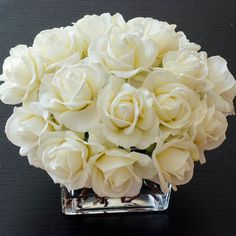 "When it comes to roses, there is never the word ""enough"". This faux floral arrangement features many many white real touch roses and it's perfect for home decor, wedding centerpiece or event use. The roses look like they are hand-picked from the garden and arranged carefully in this..."
