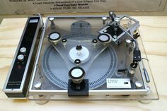 IMF Transcription 300 turntable. One of the rarest turntables in existence, few have either seen or heard of this piece of Plexiglas perfection which appeared in the mid nineteen seventies. Designed and manufactured by IMF Electronics, it reputedly won several design awards. Unusually for its time, the deck used an electronic speed controller to drive the split-level podule platter via a fine rubber belt. Beneath the perspex plinth assembly was a 30cm aluminium disc which added mass to the…