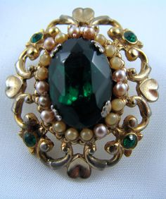"very old signed ""Coro"" some discolouration to tiny seed pearls large emerald green stone http://vintagecollector.ca/"