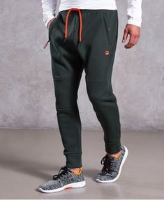 Shop Superdry Mens Gym Tech Pique Joggers in Olive. Buy now with free delivery from the Official Superdry Store. Jogger Pants Outfit, Mens Jogger Pants, Sports Trousers, Sweatpants Style, Mens Sweatpants, Track Pants Mens, Fashion Pants, Sporty Fashion, Mod Fashion