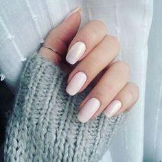Light pink natural shaped nails.