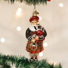 """Celebrate Christmas with the legend of Santa Claus derived from the European figure of St. Nicholas. Throughout the world Santa became the folk hero all children dream about on Christmas Eve. This Santa proudly wears a traditional tartan kilt and other clothing of the Scottish highland, as well as playing the popular musical instrument, the bagpipes. Traditionally Designed Heirloom Quality Ornaments. The Highland Santa is 5 1/4"""". Hand crafted in age-old tradition using techniques that originated Old World Christmas Ornaments, Santa Ornaments, Santa Christmas, Hanging Ornaments, Glass Ornaments, Christmas Decorations, Christmas Villages, Antique Christmas, White Christmas"""