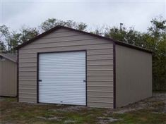 Check out this 12' x 21' x 9' Boxed Eave Eco-Friendly Steel Carport w/ Enclosure & Roll Up Door - Installation Included! Limited Quantity Available! Call 1-866-606-3991 for more information! Metal Garage Kits, Diy Garage Door, Garage Door Styles, Garage Door Makeover, Metal Shed, Metal Garages, Garage Door Design, Garage Ideas, Car Garage