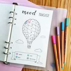 Keep track of how you feel in a mood tracker for your bullet journal. There are … Keep track of how you feel in a mood tracker for your bullet journal. There are lots of great tracker ideas including this hot air balloon! Bullet Journal Tracker, Bullet Journal Mood Tracker Ideas, Bullet Journal Notebook, Bullet Journal 2019, Bullet Journal Ideas Pages, Bullet Journal Spread, Bullet Journal Inspiration, Journal Pages, Tracker Mood
