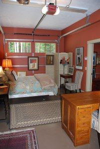 """Space Conversion: Converted Garage - think """"loft"""" to avoid freaking out over the metal rails."""