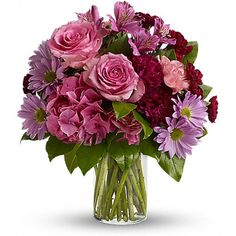 She's Extraordinary  If you want to make a vivid impression, send flowers in glorious shades of pink, maroon and lavender stunningly arranged in a sparkling clear glass cylinder vase. So much beauty for such a beautifully reasonable price tag.