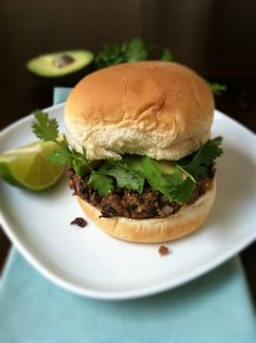 BLACK BEAN BURGERS: Mix 1 15-oz can rinsed beans, ½ T Cuban seasoning, ½ chopped onion, 1 chopped red bell pepper.  Add ½ c. Progresso bread crumbs, 1 egg.  On greased cookie sheet, bake 10 min at 375, turn over & bake 5 min more.  Top with 2 slices avocado, a squeeze of lime juice, cilantro.  Serve w/lime wedge on side.  Makes 4 burgers.