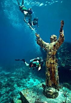 Christ of the Abyss is a 8 1/2 foot, 4000 pound bronze sculpture of Jesus that stands in 25 feet of water off of Key Largo, Florida. It is located near Dry Rocks, about six miles east-northeast of the Key Largo Cut, in the John Pennekamp Coral Reef State Park. Christ of the Abyss is one of the most famous and popular underwater sites in the only underwater park in the world.