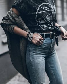Medium wash + black graphic tee/belt + grey sweater