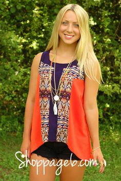 We are obsessed with this vintage design tank featuring a little color blocking with Burnt Orange and Dark Navy and a gorgeous detailed pattern down the front. Down the middle of the back with the same pattern. Sheer feel. Looks amazing with Black denim and lovely Gold accessories.      100% Polyester  Hand Wash Cold  Dry Flat  No Bleach