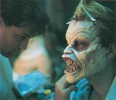 Robert Kurtzman prepares Richard Domeier's prosthetic make-up for Evil Ed for Evil Dead 2.