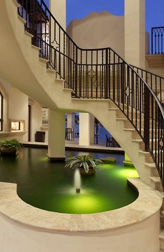 That indoor pond would look great with some Koi fish. don't like the modern look, but great idea.