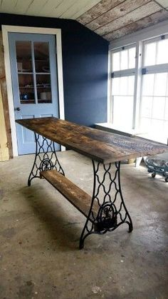 Table from reclaimed barnwood and base of Singer sewing machine. Made by…