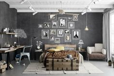 Love the scattered picture frames on another wall, not as headboard for dill. Built in desk out of reclaimed wood with metal chair, perfect. Also love the extra blanket on the bed. The blanket and curtains add the correct amount of texture and softness without taking away from the industrial, manly feel.