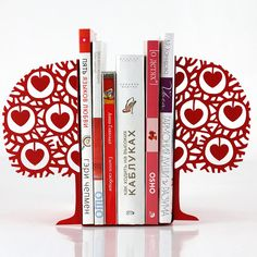 "Love and Scandinavian inspired design. Magnificent combination. Powder coated velvety red laser cut metal bookends.    Powder coated laser cut metal. One piece measures approximately 5""9 by 4""3 with base measuring 4""72 in (15 by 11 by 12 cm). Sold by a pair only.    Air delivery from Ukraine by registered mail with tracking & insurance. Please allow 10-15 days for delivery to North America and Japan, Australia - 18 to 25 days and 8 to10 days to Europe."