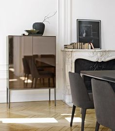 thedpages:  Bronze mirrored Orione highboy by Antonio Chitterio for Maxalto.