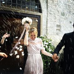 Ex-Gucci creative director Frida Giannini married her ex-Gucci CEO partner Patrizio Di Marco in a beautifully traditional wedding in Rome over the weekend.  And the bride wore...Valentino. Lace long sleeve custom gown.  ELLE Wedding.