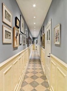 for narrow hall: the patterned floor adds interest and makes it feel wider. chair rail makes if feel higher and adds interest. light neutral color, light ceiling. bright lights evenly spaced. pictures put up higher, a collection of different colors that coordinate with wall and not too cluttered to break up the length of the hall. doors bright white