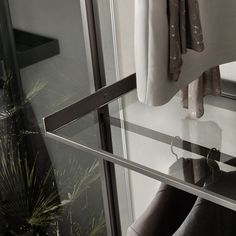 tempered glass or melamine shelf with aluminium ring, available also with integrated clothes stand rod