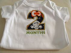 No more cheap stickers!  Custom monthly onesie for my baby boy.  Thanks Twinkle Winks!