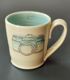 handcrafted ceramic mug with cute 35mm camera drawing on it smile word bubble on interior Dimensions H x W 4 5 x 3 5 inches Add 1 inch for the handle Holds approx 400 ml