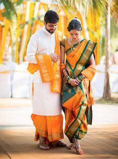 marathi bride with bridegroom on yellow nauvari saree