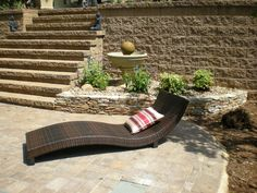 Retaining wall with steps that comes down to the paver decking around the pool.