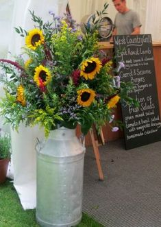 Wedding Flower Decoration - Perfect for a barn wedding…I love the humble milk churn. Milk churn is great for arrangements outside a barn or marquee then you can use them in your own garden! Rustic wedding flowers look the best and you can fill . Neutral Wedding Flowers, Romantic Wedding Flowers, Cheap Wedding Flowers, Wedding Flower Decorations, Flower Bouquet Wedding, Wedding Sunflowers, Wedding Ideas, Rustic Wedding, Aisle Decorations