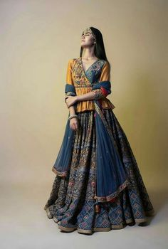 Accentuate your innate desi charm with this magical creation by Samant Chauhan. Whatsapp us now for personal shopping experience! WhatsApp us for Purchase & Inquiry : Buy Best Designer Collection from by Indian Fashion Designers, Indian Designer Outfits, Designer Dresses, Indian Attire, Indian Outfits, Choli Dress, Garba Dress, Ghagra Choli, Navratri Dress