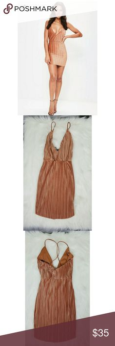 Missguided Orange Pleated  Velvet  Bodycon Dress NWT never been worn  no flaws nor defects misguided dress. This is a strappy dress with non adjustable straps and with stretch. This dress is machine washable and is made of 96% polyester and 4% elastane. If you have any questions regarding this beautiful dress please don't hesitate to ask. Thank you for visiting my closet 😍 Missguided Dresses Mini