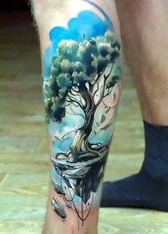 The best tree tattoo inked on the calf of a man. Style: New School. Color: Colorful. Tags: Best, Great