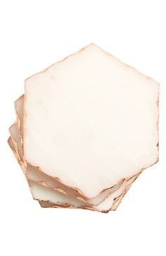Gilt edges underscore the sophisticated style of this set of geometric marble coasters.