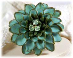 This Green Dahlia flower brooch offers hand blended petals in mint seafoam green tones with three Swarovski bicone crystals in the center. Green Flowers, Flowers In Hair, Dahlia Flowers, Flower Brooch, Brooch Pin, Teal Jewelry, Polymer Clay Flowers, Flower Center, Pretty Rings