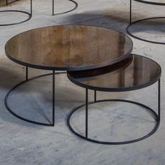 Notre Monde Bronze Nest Coffee tables Elegant and stunning addition to our furniture collection. A heavy aged mirror with bronze details and a black metal frame