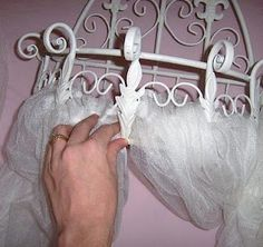 Canopy for above a little girl's bed. Spray paint a wire basket that hangs on the wall the desired color. Attach tulle and hang it above the bed. Can put stuffed animals in the basket and tie back the fabric on each side.  SCROLL DOWN TOWARD THE BOTTOM