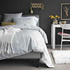 dark gray bedroom by Mudrick, via Flickr - <3 except for the light fixture and the painting. Nice bedroom.