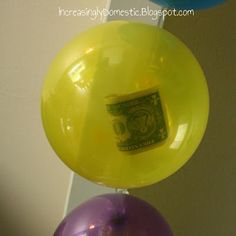 how fun!!One dollar for each year in separate balloons.  Then they pop them after cake and presents. What a great birthday idea! From Increasingly Domestic blog.