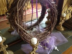 Lent decorations Grape-vine wreath w/ cross made of nails hanging on a purple ribbon.