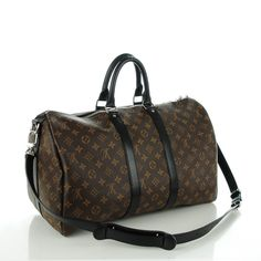 This is an authentic LOUIS VUITTON Monogram Macassar Keepall 45 Bandouliere.  This stylish travel duffel is crafted of classic Louis Vuitton monogram on toile canvas.  The bag features black leather top handles and trim and an optional shoulder strap with polished silver hardware.  The top zipper opens to a bordeaux fabric interior with zipper and patch pockets.  This is a marvelous bag for travel of all sorts, from Louis Vuitton!