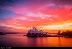 A gloriously vivid sunrise sky above the Sydney Opera House. © Spiro Nidelkos / Alamy