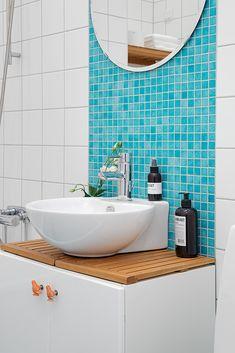 Pretty Colorful Apartment Brings Cheerful Nuance: Blue Glass Tile Bathroom Backsplash Swedish Apartment Design ~ softiv.com Apartment Inspiration