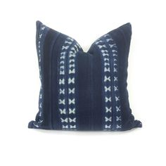 Lovely vintage African strip cloth throw pillow.  The fabric for this pillow was woven by hand and well loved.  The cloth is made by weaving long strips which are then sewn together; the whole cloth is then hand dyed using stitch resist techniques to create the unique patterns.  As the pillows are